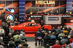 PORTLAND TRIBUNE: JEFF ZURSCHMEIDE - A 1964 Pontiac GTO goes up for sale at Mecum Auctions at the Portland Expo Center.