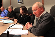 OUTLOOK FILE PHOTO - Mayor Ted Tosterud reviewing his notes in January 2014.