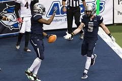 TRIBUNE PHOTO :CHRISTOPHER OERTELL - Portland Steel receiver Rashaad Carter (left) gets congratulations from Tom Gilson after a touchdown catch last week against the Cleveland Gladiators.