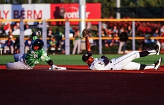 PAMPLIN MEDIA GROUP: CHASE ALLGOOD - Hillsboro Hops infielder Manny Jefferson (right) puts a tag on the Eugene Emeralds' Robert Garcia at second base during Monday night's Hops home opener at Ron Tonkin Field.