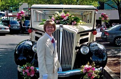 COURTESY OF SHIRLEY EDWARDS - Royal Rosarian Shirley Edwards stands in front of a classic car during a recent Rose Festival event in Portland.