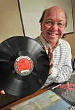 REVIEW, TIDINGS: VERN UYETAKE - Bill Baars is wearing a big grin these days because vinyl long playing records are now back at the Lake Oswego Public Library. Baars anticipates a lot of interest in them.