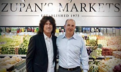 SUBMITTED PHOTO - Over Memorial Day weekend, Zupans Markets partnered with the Oregon Military Museum Project (OMMP) to support their fundraising efforts. The store donated 2 percent of the weekends sales for a total of $15,200 to the museum project. Pictured are store owner Mike Zupan and Tommy Thayer. Local ROTC volunteers helped bag customers groceries and carried them out to their cars. OMMP is a nonprofit organization founded by Tommy Thayer, Amy Maxwell and James Thayer, Jr., to raise funds needed to complete the construction and exhibits of the museum. For more information, visit oregonmilitarymuseumproject.org.  For more information about Zupans, visit zupans.com.