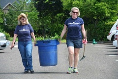 SUBMITTED PHOTO  - Windermere Stellar real estate brokers Linda Baysinger (left) and Erin Lile are all smiles as they work at the West Linn Adult Community Center during Community Service Day.