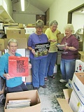 PHOTO BY ELLEN SPITALERI - Sorting through albums and books to get ready for the upcoming Friends of the Ledding Library Book Sale are, left to right, Anne Carroll, Elaine Blauvelt, Sandy Armstrong and Carol Kay.