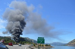 PAMPLIN MEDIA GROUP FILE PHOTO - Smoke from a derailed Union Pacific oil train burns in Mosier on June 3.