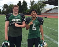 TRIBUNE PHOTO: RYAN CLARKE - The state champion Jesuit Crusaders are represented in this year's Les Schwab Bowl by North offensive lineman Griffen Marler (left) and kicker Dylan Baluyut. The North and South are working out at Pacific University for the 5 p.m. Saturday all-star game at Hillsboro Stadium.
