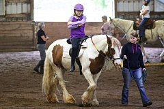TIMES PHOTO: JAIME VALDEZ - Hailee Disner rides Alex, an Appaloosa, during a therapeutic riding lesson at Forward Stride.