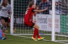 TRIBUNE PHOTO: JONATHAN HOUSE - The Portland Thorns' Mallory Weber reacts after narrowly missing a goal against the Chicago Red Stars.