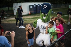 TRIBUNE PHOTO: CHASE ALLGOOD - Mascot Dillon poses with young Portland Pickles fans Wednesday night at Walker Stadium, as the home team defeats the Medford Rogues 13-1.