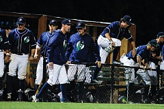 TRIBUNE PHOTO: CHASE ALLGOOD - The Portland Pickles rush the field after beating the Medford Rogues 13-1 Wednesday night for their first win at Walker Stadium.