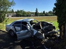 PHOTO COURTESY OF PORTLAND POLICE BUREAU - Two people were seriously injured in a vehicle crash on Northeast 162nd Avenue Saturday morning. Officers are investigating if the vehicle and its occupants were invloved in an earlier reported shooting near Northeast 105th Avenue and Glisan Street.