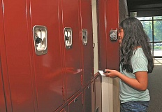 REVIEW FILE PHOTO: VERN UYETAKE - Kate Fayloga succeeds in opening her locker after a number of tries as a freshman on the first day of school at Lake Oswego High in 2013.