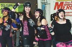 PHOTO CREDIT: STEVEN J. PRICE - Maureen 'Tyger Bomb' Weber, left-center, is a veteran Portland roller derby blocker.