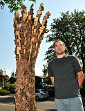 STAFF FILE PHOTO: VERN UYETAKE  - New York artist Anthony Heinz May crafted his wood sculpture onsite for Lake Oswegos Gallery Without Walls. The piece is one of 14 that was officially unveiled in late August 2015.