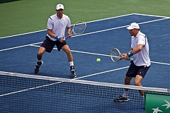 TIMES PHOTO: JAIME VALDEZ - The U.S. doubles team of Mike and Bob Bryan battle during their Saturday loss to Croatia's Marin Cilic and Ivan Dodig in the two teams' Davis Cup quarterfinal. The loss leaves the Americans' lead at 2-1 heading into a pair of singles matches on Sunday at Tualatin Hills.
