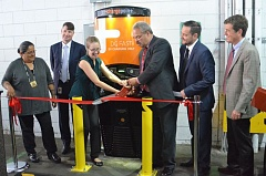 DANIELLE KLOCK - Sarah Heinicke, Lloyd EcoDistrict and state Rep. Lew Frederick (House District 43) cut the ribbon while (Lfrom left to right) Tawna Sanchez (House District 43 candidate), Scott Bolton (Pacific Power), Jon Cerino (ChargePoint) and Jeff Allen (Drive Oregon) look on.