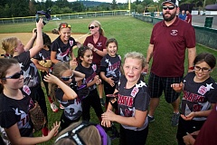 JAIME VALDEZ - Members of the Tualatin City Little League ages 8-10 all-star softball team gather before the start of Tuesday's District 4 third-place game.