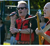 SPOKESMAN PHOTO: JAKE BARTMAN - Lance Parsons, left, and Grady McKenzie performed as a part of Johnny Limbo and the Lugnuts at the Rotary Club of Wilsonville's Summer Concerts series' opening night July 21.