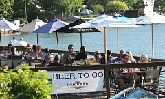 REVIEW PHOTO: VERN UYETAKE - Does it get any better on a weeknight in Lake Oswego? Patrons enjoy warm sunshine and lake breezes from the deck at Stickmen Brewing Company.