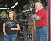 NEWS-TIMES FILE PHOTO: CHASE ALLGOOD - Bill Ballard (right) and his wife Jeanne Pfluke talk about their support for the Returning Veterans Project at their Forest Grove business, Iron Horse Garage, in 2014. Ballard died Aug. 4 in a motorcycle accident in Washington state.