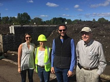SUBMITTED PHOTO - Sustainability Advisory Board members Sarah Hussion (left) and Bob Sack (right) join City Councilor Joe Buck and Sustainability Fellow Jenny Slepian on a tour of the Pacific Regional Composting Facility in Corvallis.