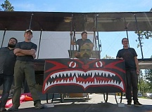 SUBMITTED PHOTO - Team Yakima members (from left) Kyle McRay, Chuck Kraeuter, Lyle Ramsdell and Tom Miron prepare their Animal House-inspired plane for last year's Flugtag competition. The 2015 event was cut short by the U.S. Coast Guard, so the team is now hoping to fly Aug. 27 in Louisville.