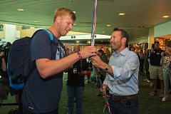 OUTLOOK PHOTO: JOSH KULLA - Gresham High School and University of Oregon graduate Sam Crouser is greeted at Portland International Airport by Gresham Mayor Shane Bemis as Crouser returns Tuesday morning from the Rio Olympics. There, he took part in the men's javelin competition, while his cousin, Ryan Crouser, earned a gold medal in the shot put.