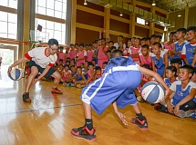 Lake Oswego head coach Marshall Cho helps put on a  clinic for youth players in China.