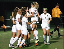 DAN BROOD - Members of the Sherwood High School girls soccer team, including returnees Rita Lang (7) and Emma Smith (15) celebrate following a Lady Bowmen goal in last year's showdown with Tualatin.