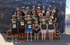CONTRIBUTED PHOTO - The 2014 Team Eye Rock walking relay group at the finish line in Seaside. Gresham's Kyle Pleasant, front row third from the left, will be competing again this year.