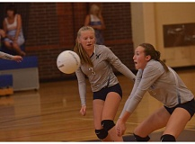 SPOKESMAN PHOTO: COREY BUCHANAN - While standing next to Gracie Thompson, Kennedy Juranek passes the volleyball to a teammate during the jamboree.