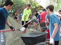 SUBMITTED PHOTO: PAUL LYONS - Lake Oswego High students shovel gravel last week as part of a project to repair trails in Springbrook Park.