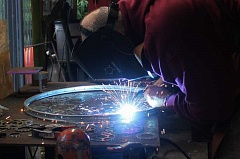 REVIEW PHOTO: KELSEY O'HALLORAN - Brian Echerer of Velo Gioielli welds bicycle-inspired artwork at his studio in Lake Oswego. He's one of more than 100 makers who will showcase their work at the fifth-annual Portland Mini Maker Faire.
