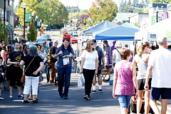 TIMES FILE PHOTO - Crowds wander Southwest Main Street at last year's Tigard Street Fair.