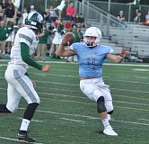 MATTHEW SHERMAN - Lakeridge quarterback Mike Irwin dodges a Wilson defender in Friday's 53-21 victory, moving the Pacers to 2-0.