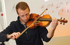 REVIEW PHOTO: VERN UYETAKE - Darian Douglas, who plays the violin, is the new orchestra teacher ar Lake Oswego High and Lake Oswego Junior High.