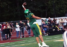 DAN BROOD - West Linn junior tight end Keishon Dawkins makes a reaching, one-handed catch for a 15-yard touchdown in the Lions' 48-14 win over Sherwood on Friday.