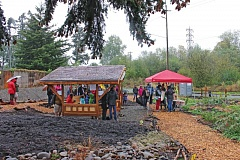 PORTLAND TRIBUNE: LYNDSEY HEWITT - Neighbors, volunteers and others gathered at the new orchard site on Saturday to celebrate despite rainy weather.