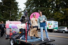 FOR THE REVIEW: ADAM WICKHAM - The four class floats were each created to represent a city. The senior float, representing Tokyo, features, from left, Godzilla with samurai Alex Shakerin and Drew Jackson.