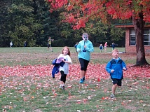 SUBMITTED PHOTO: BRETT HAYES - Run to Mtulu figures to be another big success at Uplands Elementary School on Saturday. Shown at last year's event are runners Aliya DiVergilio (left) and Grant Wise. Wearing the elephant mask is Hannah Negri.
