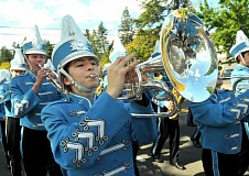 REVIEW PHOTO: VERN UYETAKE - Sophie Koh and the Pacer band marches down A Avenue during Lakeridge High School's homecoming parade on Friday.