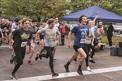 NEWS-TIMES PHOTO: CHASE ALLGOOD - Members of the Forest Grove High School cross country team get a fast start in the Run For Shelter 5K Saturday morning, an inaugural event to support temporary emergency shelters in town.