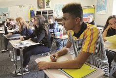 REVIEW FILE PHOTO: VERN UYETAKE - Lakeridge High School junior Darius Guinn concentrates on an English exercise during a recent class. Students in the Lake Oswego School District received high marks on a Report Card issued this Thursday by the Oregon Department of Education.