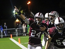 DAN BROOD - Sherwood senior David Morris points up to the Bowmen grandstands after catching a 55-yard touchdown pass in the 35-20 win over Tigard on Friday.