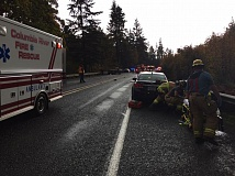 PHOTO COURTESY OF COLUMBIA RIVER FIRE AND RESCUE - Columbia River Fire and Rescue crews respond to a two vehcile head-on crash in Goble, Monday, Oct. 17. Both drivers were transported to a Portland area hospital for treatment of their injures.