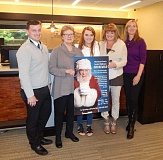 BARBARA SHERMAN - Gathered together at HomeStreet Bank to kick off the 2016 local foster children's giving tree program are (from left) HomeStreet Bank Vice President/Branch Manager Jacob Piling; giving tree organizer Kathy Peper; Amber and Andrea O'Connor with the SCOTTY Foundation; and Cari Lindsey, Summerfield Civic Association administrator.
