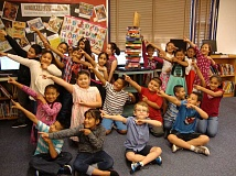 COURTESY NELLIE MUIR ELEMENTARY SCHOOL - Third-grade students at Nellie Muir Elementary School pose with the Woodburn Reads trophy.