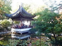 BARBARA SHERMAN - Deer Creek third-graders look like they are taking a magical boat ride as they gather in a pavillion in the Lan Su Chinese Garden in Portland.