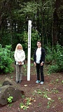 SUBMITTED PHOTO - Sherwood Rotarians Maureen Clifford, at right, and Karen Strickland are pictured with the new peace pole established at St. Francis Church.  Ms. Clifford is the chair of Rotarys Peace Committee and a member of St. Francis.